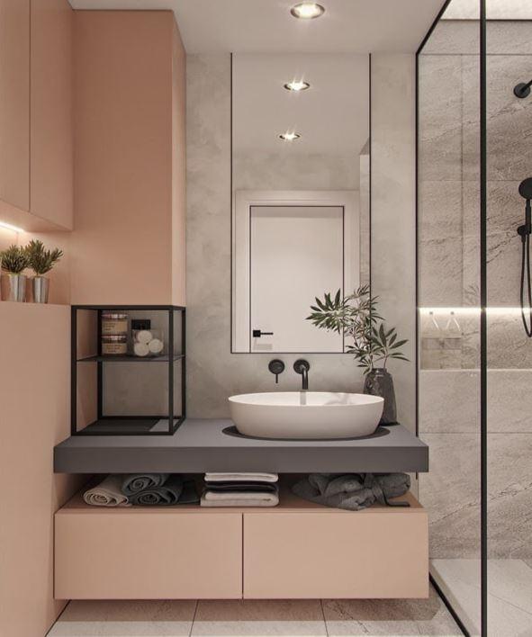Gam màu hồng - xám là một ý tưởng hay cho không gian tắm nhỏ